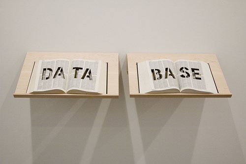 "DATABASE at Postmasters, March 2009  DATA BASE is an Oxford English Dictionary with the word ""DATA BASE"" cut into it with the laser cutter."