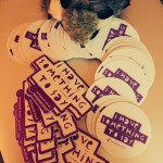 """Tiny Raccoon sits atop a pile of stickers that say """"I have something to say"""""""