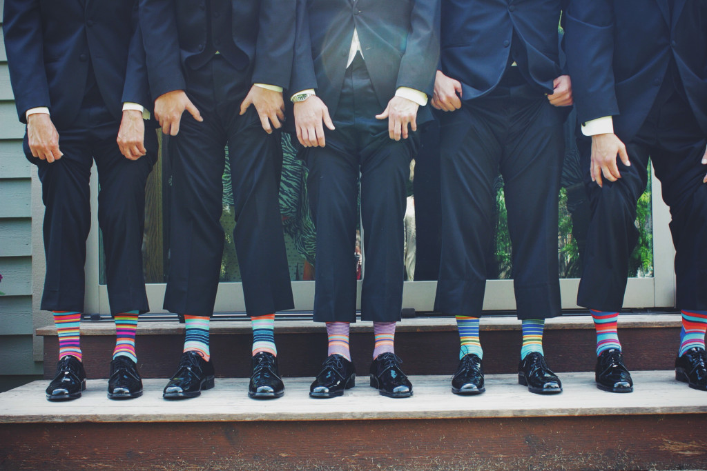 "I think of this picture as ""they think they are different because they are all wearing different socks"""
